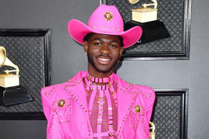 a little girl wearing a pink hat: Frazer Harrison/Getty Images Lil Nas X