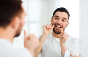 a person brushing the teeth: You probably know it's important to brush your teeth every day, but if you want to protect your pearly whites for a lifetime, there's more to consider when it comes to your oral health routine. Here are 20 tips to help you take care of your teeth.
