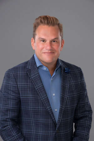Duff Rubin wearing a suit and tie: Duff Rubin is the president of Coldwell Banker Realty in Florida