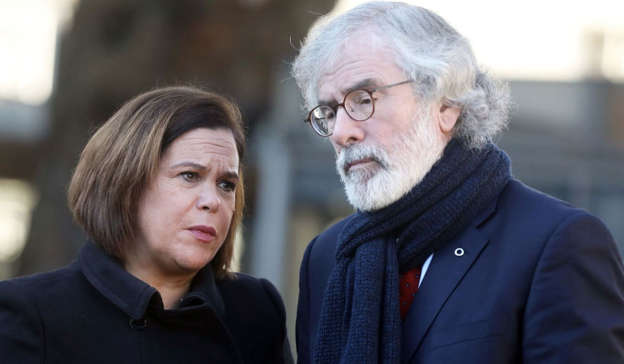 Mary Lou McDonald wearing a suit and tie: For nearly 50 years Gerry Adams was the leader of the political wing for the most successful paramilitary murderer gang in the Western world.. Photo: Leah Farrell/RollingNews.ie