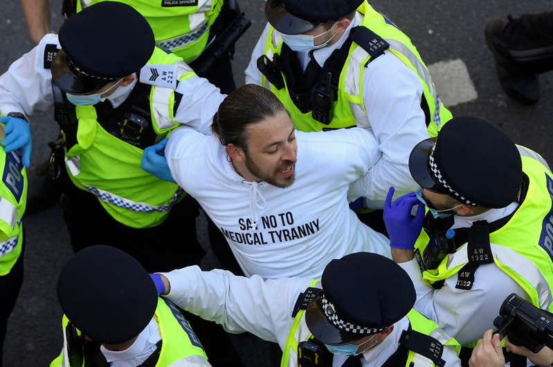 Police detain a demonstrator during an anti-lockdown 'Unite for Freedom' protest, amid the spread of the coronavirus disease (COVID-19), in London, Britain, April 24, 2021. REUTERS/Toby Melville