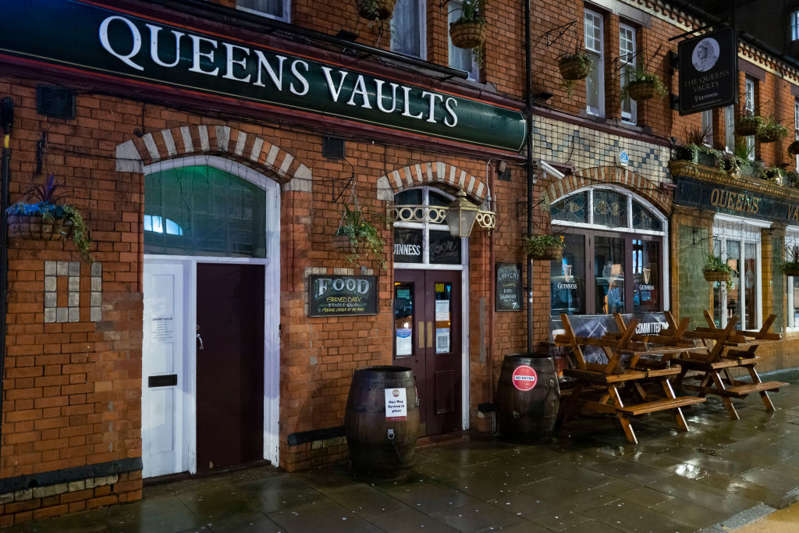 CARDIFF, WALES - DECEMBER 18: A closed Queens Vaults pub on Westgate Street on December 18, 2020 in Cardiff, Wales. A two-household limit will be in place from December 23 to December 27 and three in the rest of the UK. In Wales, non-essential shops will close at the end of trading on Christmas Eve with an alert level four lockdown starting four days later. Close-contact services, such as hair salons also have to shut before Christmas, and all pubs, cafes and restaurants will close at 18:00 GMT on Christmas Day. (Photo by Matthew Horwood/Getty Images)