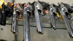 a close up of a toy: A display of guns for sale is seen at Coliseum Gun Traders Ltd. in Uniondale, New York on September 25, 2020. -