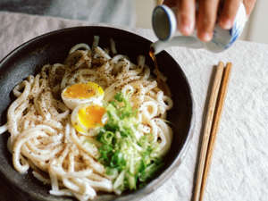 a bowl of food: Swirling, slurping, and sliding into noodle-fueled ecstasy on a family pilgrimage to Tokyo.
