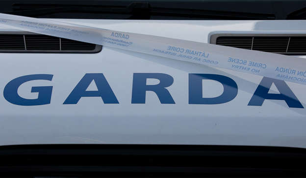 a car parked in front of a sign: A man aged in his mid-20s was arrested at the scene, and has been detained at Ballymote Garda Station under the provisions of Section Two of the Criminal Justice (Drug Trafficking) Act 1996. Pic: Gareth Chaney/Collins Photos