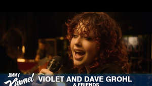 "a close up of a person: Violet and Dave Grohl & Friends perform a cover of the song ""Nausea"" on Jimmy Kimmel Live.