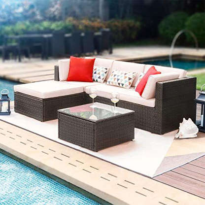 Slide 7 of 21: $399.99Shop NowOutdoor furniture can get really pricey, but if you don't want to drop a lot of money on something you'll only use for a few months, this set is proof you don't have to. This modern sectional sofa comes with thick, comfortable cushions, as well as a glass top table. You can keep it together to use it as a sofa, or separate it into two chairs.
