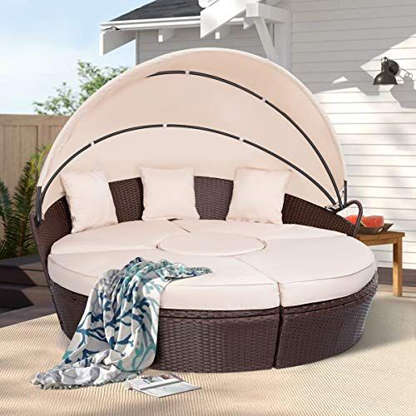 Slide 9 of 21: $1249.99Shop NowGive your space a luxurious feel with this super comfortable daybed that encourages all of the lounging and sunbathing. It has a retractable canopy for shade, and can comfortably hold up to four people at a time. The seats can be left combined or separated, and the cushion is thick and comfortable.