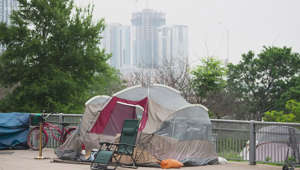 a chair sitting in front of a fence: City of Austin releases homeless camping ban enforcement plan