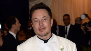 Elon Musk wearing a suit and tie