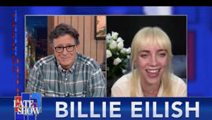 "a screen shot of Stephen Colbert: GRAMMY-winning superstar Billie Eilish, who can now add ""author"" to her list of accolades, returns to A Late Show to tell Stephen about her journey to become a blonde, and what it was like watching the internet react to her revealing ""Vogue"" cover shoot. Her book, ""Billie Eilish"" is out now and her upcoming album, ""Happier Than Ever,"" drops on July 30th. Stick around to watch Billie and her brother FINNEAS perform her new single, ""Your Power."" #HappierThanEver #BillieEilishVogue #BillieEilish  Subscribe To ""The Late Show"" Channel: http://bit.ly/ColbertYouTube Watch full episodes of ""The Late Show"": http://bit.ly/1Puei40 Like ""The Late Show"" on Facebook: http://on.fb.me/1df139Y Follow ""The Late Show"" on Twitter: http://bit.ly/1dMzZzG Follow ""The Late Show"" on Instagram: http://bit.ly/29wfREj  Watch The Late Show with Stephen Colbert weeknights at 11:35 PM ET/10:35 PM CT. Only on CBS.  --- The Late Show with Stephen Colbert is the premier late night talk show on CBS, airing at 11:35pm EST, streaming online via Paramount+, and delivered to the International Space Station on a USB drive taped to a weather balloon. Every night, viewers can expect: Comedy, humor, funny moments, witty interviews, celebrities, famous people, movie stars, bits, humorous celebrities doing bits, funny celebs, big group photos of every star from Hollywood, even the reclusive ones, plus also jokes."
