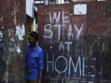 a man standing in front of a building: COVID-19 Delta Plus variant cases rise to 51, Maharashtra reports first death; all you need to know