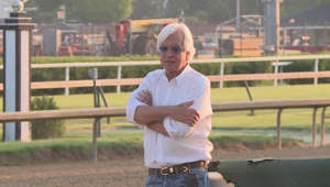 Bob Baffert standing in front of a fence: Failed tests: What's Bob Baffert's track record?
