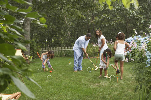 Slide 2 of 22: Get everyone outside by hosting a tournament of DIY lawn games for family and friends.