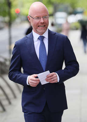 Stephen Donnelly wearing a suit and tie: Minister for Health Stephen Donnelly said he 'doesn't know' what the point of the Iveagh Gardens pilot gig as Pat Kenny 'tore strips' off him. Pic: Brian Lawless/PA Wire
