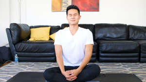 Charles Chen sitting on a sofa: How 2 Minutes of Meditation a Day Can Totally Change Your Life