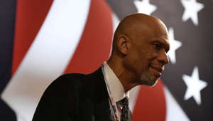"a man wearing a suit and tie: Kareem Abdul-Jabbar on the progress of racial equality, ""It doesn't all happen at once. It takes a lot of back and forth. But we can get there."""