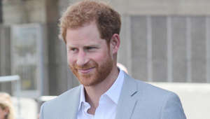 Prince Harry wearing a suit and tie