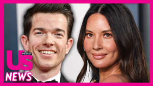 a close up of John Mulaney, Olivia Munn posing for a photo
