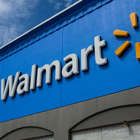 a blue sign in front of a building: Exterior view of a Walmart store on August 23, 2020 in North Bergen, New Jersey. Walmart saw its profits jump in latest quarter as e-commerce sales surged during the coronavirus pandemic.