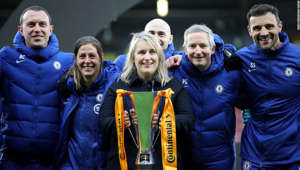 Bart Caubergh, Denise Reddy posing for the camera: WATFORD, ENGLAND - MARCH 14: Emma Hayes, Head Coach of Chelsea Women's celebrates with the trophy and her backroom staff after her teams victory during the FA Women's Continental Tyres League Cup Final match between Bristol City Women and Chelsea Women at Vicarage Road on March 14, 2021 in Watford, England. Sporting stadiums around the UK remain under strict restrictions due to the Coronavirus Pandemic as Government social distancing laws prohibit fans inside venues resulting in games being played behind closed doors. (Photo by Naomi Baker/Getty Images)
