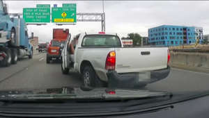 a truck that is driving down the road: APD: Most road rage incidents involve guns