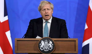 Boris Johnson wearing a suit and tie