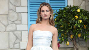 Lily James wearing a dress