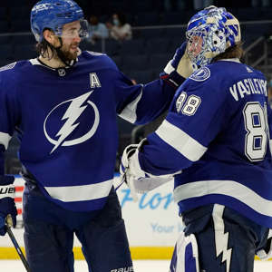 Tampa Bay Lightning goaltender Andrei Vasilevskiy (88) celebrates with defenseman Victor Hedman (77) after the team defeated the Dallas Stars during an NHL hockey game Wednesday, May 5, 2021, in Tampa, Fla. (AP Photo/Chris O'Meara)