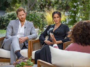 Prince Harry, Mary-Kate Olsen sitting at a table: harry meghan