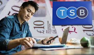 a person sitting at a table using a laptop: tsb interest rates