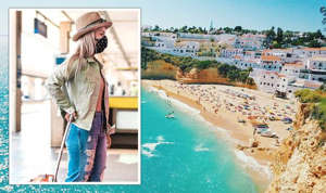 a person standing next to a river: Foreign holidays 'not a good idea' as holidaymakers jet off to 'green' list countries