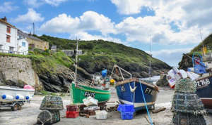 a boat parked on the side of a building: The University of Oxford professor said people should visit places like Cornwall this year