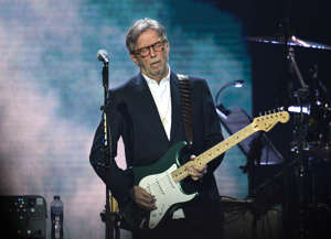 Eric Clapton holding a guitar: Eric Clapton released an anti-lockdown track last year.