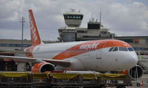 a large passenger jet sitting on top of a runway: Flights will be cheap this summer