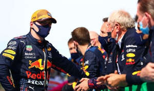 a group of people in uniform: Max Verstappen