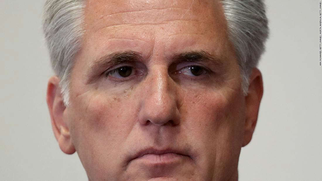 """a close up of Kevin McCarthy looking at the camera: WASHINGTON, DC - JULY 24: House Majority Leader Kevin McCarthy (R-CA) participates in a weekly press conference with Republican House leaders at the U.S. Capitol July 24, 2018 in Washington, DC. When asked about U.S. President Donald Trump's threat of revoking security privileges of political opponents, Speaker of the House Paul Ryan said he thought Trump was """"trolling"""" his political opponents. (Photo by Win McNamee/Getty Images)"""