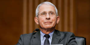 Anthony S. Fauci wearing a suit and tie