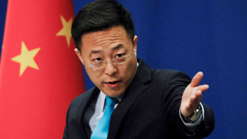 a man wearing a suit and tie: Chinese Foreign Ministry spokesman Zhao Lijian said Australia should end its 'cold war mentality'.