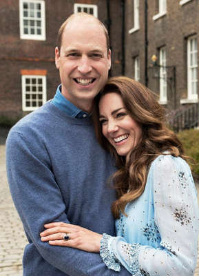 Prince William, Duke of Cambridge standing in front of a building: The Duke and Duchess of Cambridge, Kate and William, pose for their 10th anniversary portraits Pic: Chris Floyd/PA