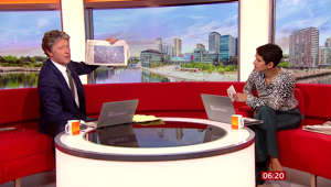 Charlie Stayt sitting at a table in front of a window: BBC Breakfast: Naga says she 'hasn't got time for a quiz'