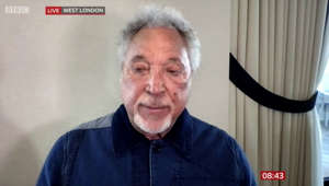 Tom Jones wearing a blue shirt: Sir Tom Jones says his late wife 'loved The Voice'