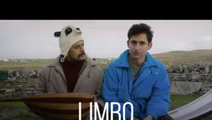 a man sitting on a table: An unexpected comedy about following a dream, no matter where it takes you. #LIMBO is a film by Ben Sharrock. In theaters April 30.   Limbo is a wry and poignant observation of the refugee experience, set on a fictional remote Scottish island where a group of new arrivals await the results of their asylum claims. It centers on Omar (Amir El-Masry), a young Syrian musician who is burdened by his grandfather's oud, which he has carried all the way from his homeland.  https://www.focusfeatures.com/limbo  https://twitter.com/LimboFilm  https://www.instagram.com/limbofilm/  https://www.facebook.com/LimboFilm
