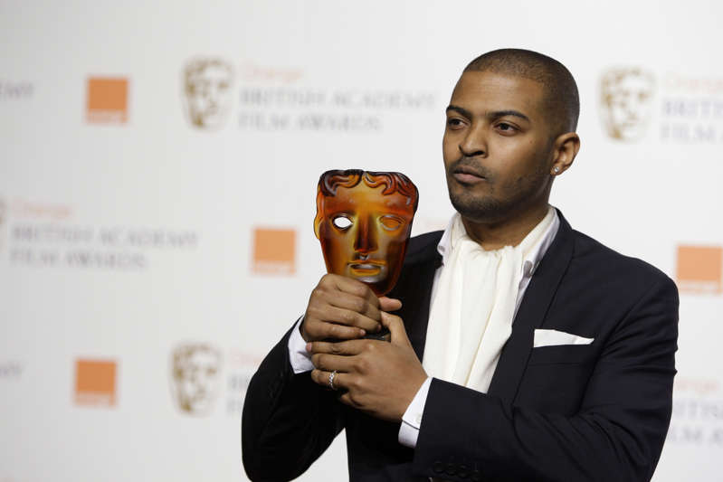 In this Sunday, Feb. 8, 2009 file photo, British actor and director Noel Clarke, displays his Orange Rising Star Award at the British Academy Film Awards 2009 at The Royal Opera House in London, England. Britain's motion picture academy on Thursday April 29, 2021, suspended actor-director Noel Clarke after a newspaper reported that multiple women had accused him of sexual harassment or bullying. (AP Photo/Joel Ryan, File)