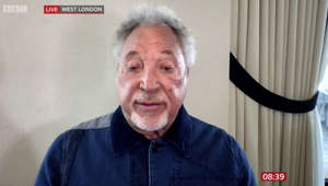 Tom Jones wearing a blue shirt: Sir Tom Jones discusses 'importance' his wife had in his life