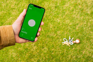 a hand holding a cellphone: Finding a nearby AirTag is a fun, interactive experience. Sarah Tew/CNET