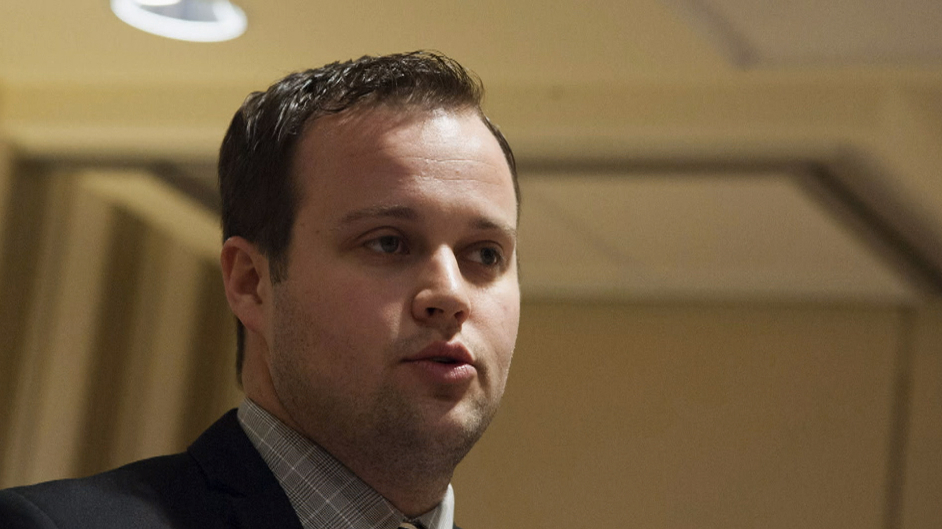 """Josh Duggar wearing a suit and tie looking at the camera: Police records show Josh Duggar was accused of molesting five underage girls in 2002. The eldest of the 19 children of Jim Bob and Michelle Duggar released a statement saying, """"I acted inexcusably for which I am extremely sorry."""""""