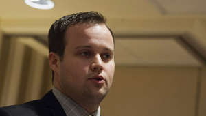 "Josh Duggar wearing a suit and tie looking at the camera: Police records show Josh Duggar was accused of molesting five underage girls in 2002. The eldest of the 19 children of Jim Bob and Michelle Duggar released a statement saying, ""I acted inexcusably for which I am extremely sorry."""