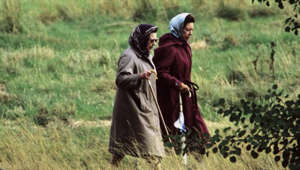 a person standing on top of a grass covered field: Queen and Margaret 'picked Bilberries in Balmoral' says Burrell
