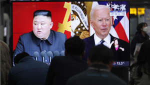 Kim Jong-un, Joe Biden are posing for a picture: Commuters watch a TV showing a file image of North Korean leader Kim Jong Un and US President Joe Biden during a news programme in Seoul, South Korea, Friday. March 26, 2021.